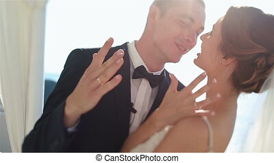 Happy fabulous couple kisses at wedding aisle tent and shows...