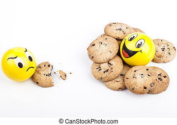 Happy Face and sad Face yellow balls with chocolate chips cookies
