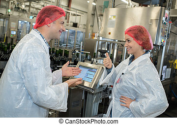 happy factory workers talking