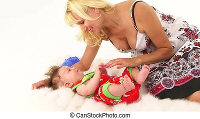 Happy Fair Haired Mother Playing With Her Small Baby Boy -...