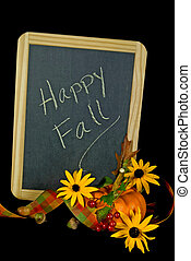 Happy Fall - Fall message on blackboard with autumn objects.