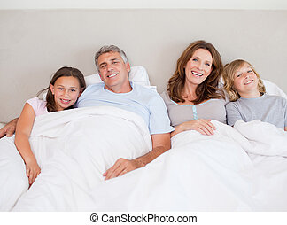 Happy family about to take a nap
