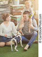 happy family and pet dog on the background of country house