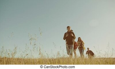 happy family are running slow motion video walking on nature...