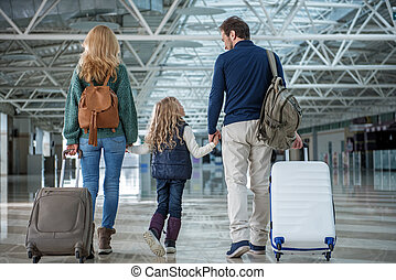 Happy family arriving at the destination - Glad parents and ...