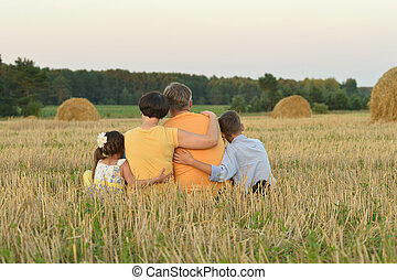 happy family at a field