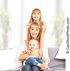 happy family at home on couch. Mother and daughter and son -...