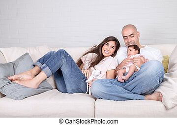 Happy family at home, cheerful young parents with cute...
