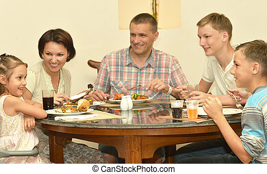Happy family at home - Portrait of a happy family eating at...