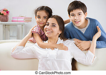 Happy family at home - Happy mother with her little children...