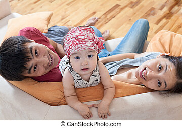 Happy family at home on sofa