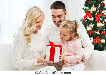 happy family at home with christmas gift box - family,...