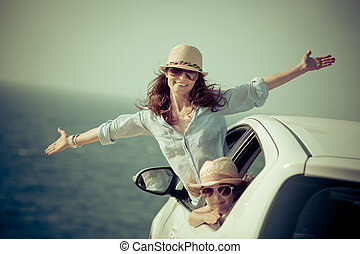Happy family at the beach. Summer car trip. Vacations concept