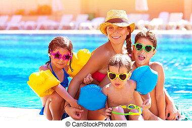Happy family at the pool - Happy big family having fun at...