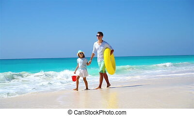 Happy family at tropical beach having fun - Happy father and...