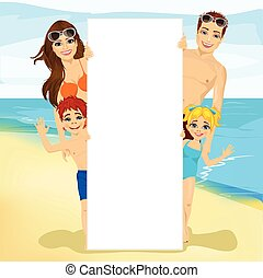 happy family behind a white blank billboard at the beach