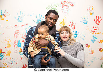 Happy family: black father, mom and baby boy. Use it for a ...