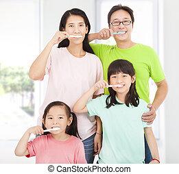 happy family brushing their teeth