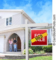 Happy Family Buying a New Home - A happy family is standing...