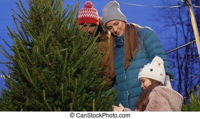 happy family buying christmas tree at market - family, ...