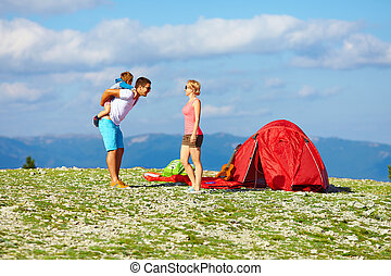 happy family camping in mountains