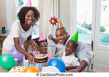 Happy family celebrating a birthday together at table