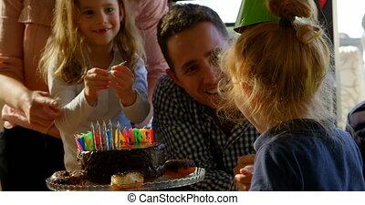 Happy family celebrating birthday in living room 4k