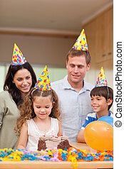 Happy family celebrating daughters birthday