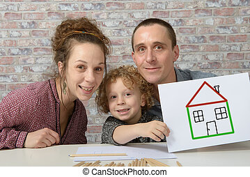 happy family, child holding paper with drawing house