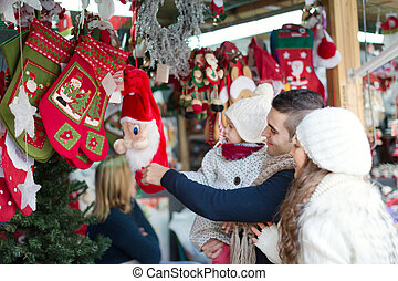 Happy family choosing Christmas decoration at Christmas ...