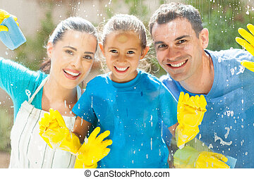 happy family cleaning window glass