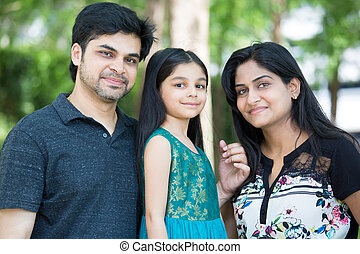Happy family - Closeup portrait, adorable family posing...