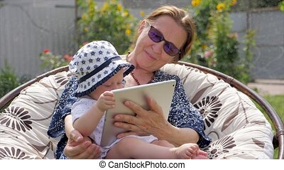 Happy family concept. Grandmother with granddaughter.