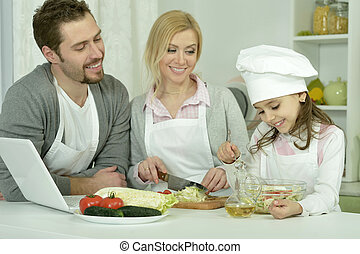 happy family cooking  in kitchen