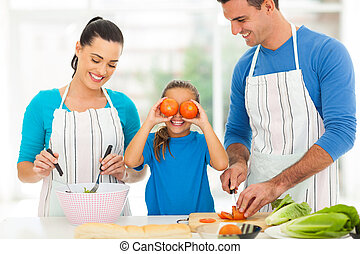 happy family cooking in kitchen - happy young family cooking...