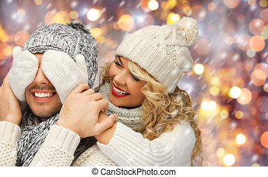 happy family couple in winter clothes having fun - people, ...