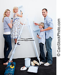 Happy Family decorating their new home