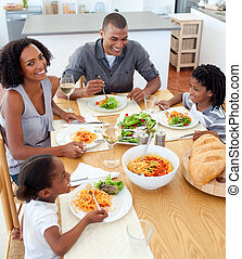 Happy family dining together