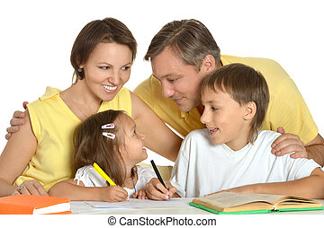 family drawing at the table
