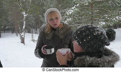 Happy family drinking hot tea outside in winter 96fps