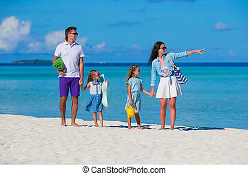 Happy family during summer vacation on white beach - Happy ...