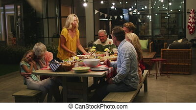 Happy family eating dinner together. - Multi-generation ...