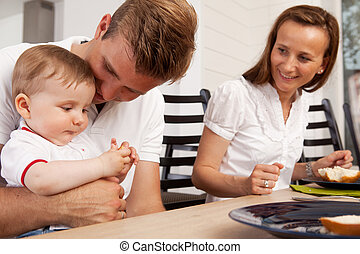 Happy Family Eating Meal