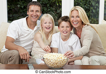 Happy Family Eating Popcorn Watching Television