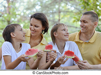 Happy family eating