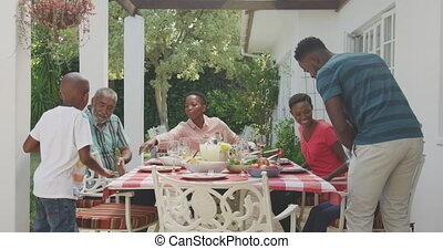 Happy family eating together at table