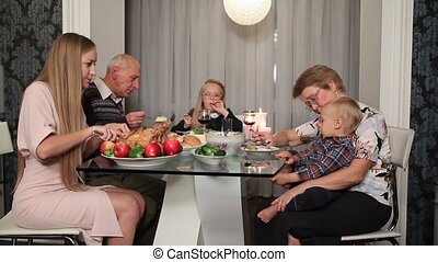 Happy family eating traditional Thanksgiving food - Happy...