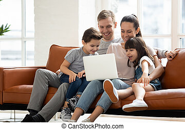 Happy family enjoy using laptop make online call at home