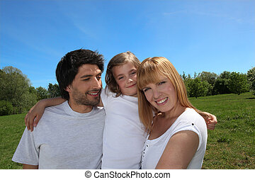 Happy family enjoying a day out in the sunshine together