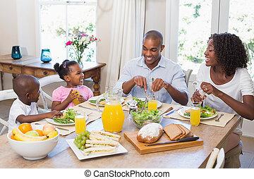 Happy family enjoying a healthy mea